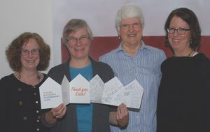 Celebrating Lisa Byers' 20th year as OPAL's executive director are (left to right) OPAL co-founder and trustee Penny Sharp Sky, Lisa Byers, returning trustee Helen Bee, and newly elected trustee Anne Bertino.